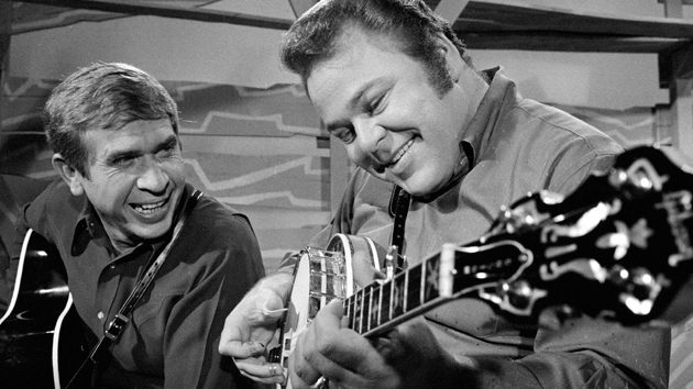 """Roy Clark, foreground, with Buck Owens on """"Hee Haw""""; CBS via Getty Images"""