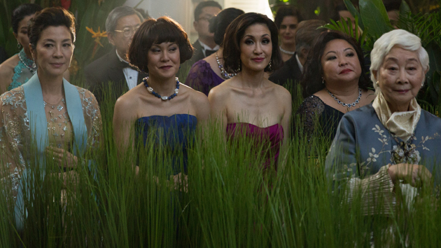 """L-R: Michelle Yeoh, Janice Koh, Amy J. Cheng, Selena Tan, Lisa Lu and Gemma Chan in """"Crazy Rich Asians""""; Sanja Bucko/Warner Bros. Pictures"""