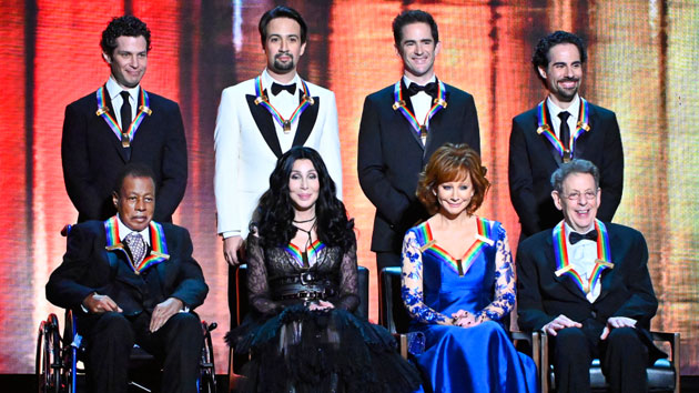 L-R, standing: Thomas Kail, Lin-Manuel Miranda, Andy Blankenbuehler and Alex Lacamoire. LR, sitting: Wayne Shorter, Cher, Reba McEntire, and Philip Glass; Michele Crowe/CBS