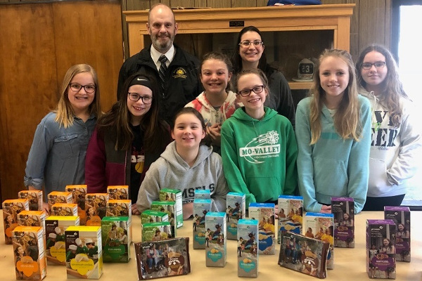 Girl Scouts donate cookies CACCC