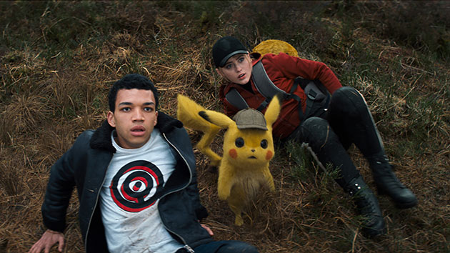 "Justice Smith and Kathryn Newton in ""Pokémon Detective Pikachu""; courtesy of Warner Bros. Pictures"