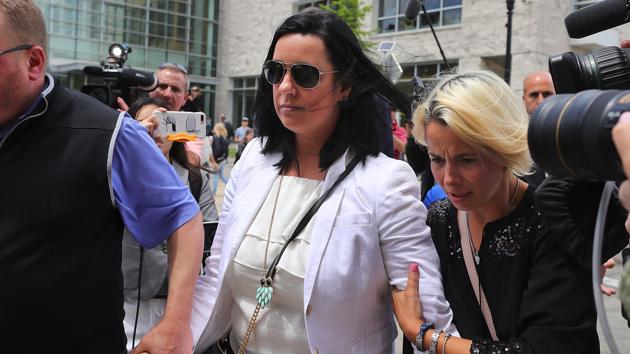 Conrad Roy's mother, Lynn Roy, is escorted from court on June 16, 2017. John Tlumacki/The Boston Globe via Getty Images