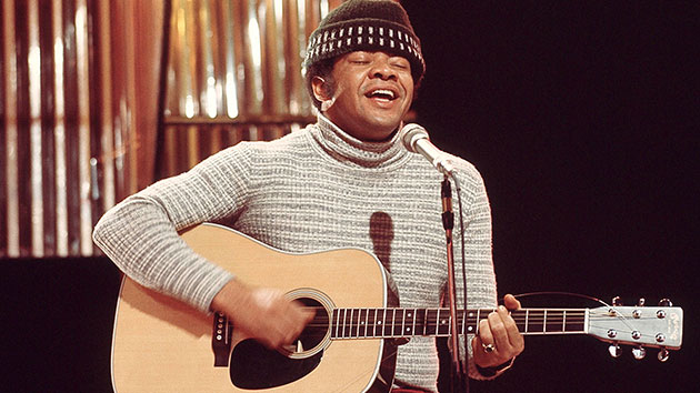Bill Withers performing in 1972; Michael Putland/Getty Images