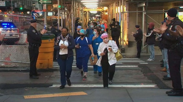 Members of the NYPD cheered as visiting health workers headed to their last shifts on April 22, 2020, in New York City. - (WABC)
