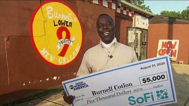 """Burnell Cotlon receives a donation live on """"Good Morning America"""" for his grocery store to help residents amid the COVID-19 pandemic pay for groceries. - (ABC News)"""