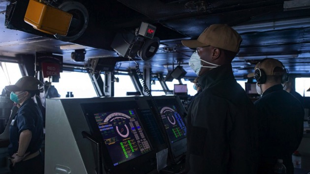 Seaman Cameron Davis mans the helm of the aircraft carrier USS Theodore Roosevelt (CVN 71) as the ship operates in the Philippine Sea, May 21, 2020, following an extended visit to Guam in the midst of the COVID-19 global pandemic. - (Mc3 Zachary Wheeler/U.S. Navy)