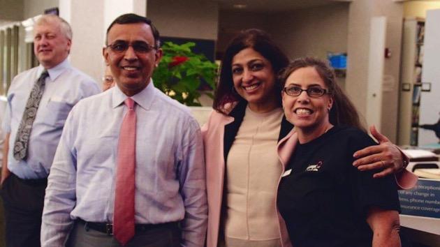 Dr. Omar Atiq, far left, an oncologist, forgave his patients' around $650,000 medical debt.- (Courtesy Omar Atiq)