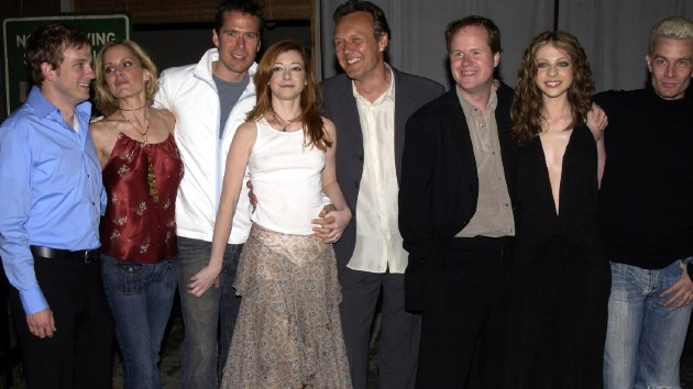 "Head, center, next to Whedon with ""Buffy"" cast members in 2003 -- Albert L. Ortega/WireImage"